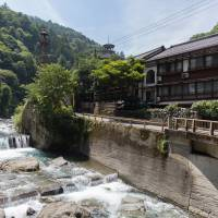 A Japanese inn overlooks a river at Shimobe-Onsen in Yamanashi Prefecture. | BENJAMIN PARKS