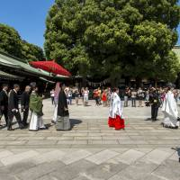 The big day: A wedding procession marches through a shrine, a more public affair than the nuptials of many celebrities. | ISTOCK