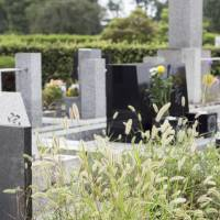 Dead pricey: Burial in Japan has become an expensive affair, and Shukan Post suggests that rather than purchase a cemetery plot, relatives have been simply 'forgetting' the ashes of their loved ones in public places. | ISTOCK