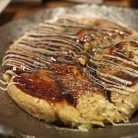 Okonomiyaki is a popular dish from Osaka, a city known for its hearty, down to earth cuisine. | MAKIKO ITOH