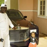 Darien poses with his youngest daughter at his home in Abuja. | DREUX RICHARD