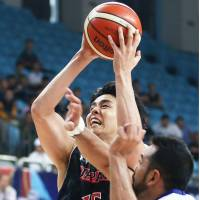 Japan's Joji Takeuchi takes  a third-quarter shot during Friday's game against India at the FIBA Asia Championship in Changsha, China. Japan defeated India 83-65. | KYODO