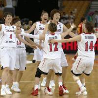The Japan women's national team celebrates its 85-50 triumph over China in the FIBA Asia Women's Championship final on Saturday in Wuhan, China. | KYODO