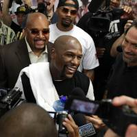 Floyd Mayweather Jr. responds to questions during his workout in Las Vegas, on Aug. 26. Mayweather will meet Andre Berto in a welterweight title bout on September 12. | AFP-JIJI