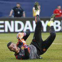 Manchester United goalkeeper David De Gea will remain at Old Trafford after his proposed transfer to Real Madrid fell through on Monday. | AP