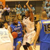 Veteran big man Marcus Cousin (second from right) brings NBA experience to the Shinshu Brave Warriors. | THE JAPAN TIMES
