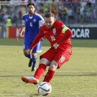 Rooney ties record as England qualifies