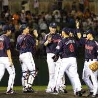 The Swallows celebrate after their win over the Giants on Wednesday.   KYODO