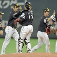 The Fukuoka Softbank Hawks celebrate their 7-3 win over the Hokkaido Nippon Ham Fighters on Thursday night at Sapporo Dome. | KYODO