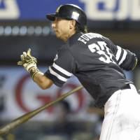Shuhei Fukuda hits an RBI triple during the 10th inning of the Hawks' win over the Eagles on Sunday in Sendai. | KYODO