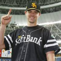 Rick van den Hurk poses for photos after picking up his ninth win of the season for the Hawks on Wednesday in Osaka. | KYODO