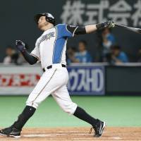 The Fighters' Brandon Laird belts a three-run home run in the sixth inning against the Lions on Sunday at Sapporo Dome. Hokkaido Nippon Ham beat Seibu 9-7. | KYODO