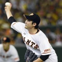Giants hurler Tomoyuki Sugano fans 10 batters over seven innings on Tuesday against the archrival Tigers at Tokyo Dome. Yomiuri defeated Hanshin 3-0.   KYODO