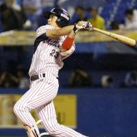 Swallows slugger Tetsuto Yamada hits a solo home run in the first inning against the BayStars on Thursday night at Jingu Stadium. Yamada finished with two round-trippers in Tokyo Yakult's 4-2 victory over Yokohama. | KYODO