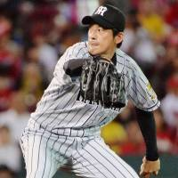 The Tigers' Atsushi Nomi pitches against the Carp on Friday at Mazda Stadium. Nomi worked seven scoreless innings in Hanshin's 3-0 win over Hiroshima.   KYODO