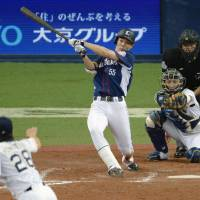Seibu's Shogo Akiyama connects on his NPB record-tying 214th hit of the season during the eighth inning of the Lions' 16-5 win over the Buffaloes on Wednesday in Osaka. | KYODO