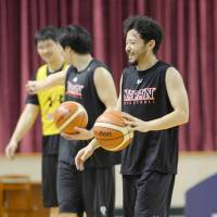 Japan guard Yuta Tabuse smiles during practice on Wednesday. | KYODO