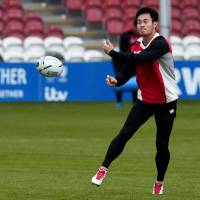 Japan winger Kenki Fukuoka passes a ball during a training session at Kingsholm Stadium in Gloucester, England, ahead of Wednesday's Rugby World Cup game against Scotland. | AFP-JIJI