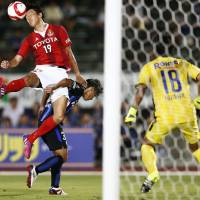 Kisho Yano heads the ball during Nagoya Grampus' 1-1 draw against Gamba Osaka in the first leg of their Nabisco Cup quarterfinal on Wednesday. | KYODO
