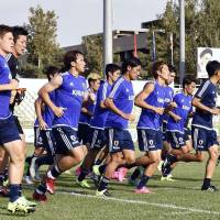 Japan's players go through their paces in Tehran on Sunday ahead of Tuesday's World Cup qualifier against Afghanistan. | KYODO
