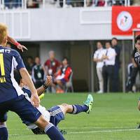 Montedio's Kim Byeom-yong scores against Yamaga on Wednesday in Matsumoto, Nagano Prefecture. The match ended in a 2-2 draw. | KYODO