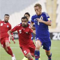 Keisuke Honda controls the ball during Japan's match on Tuesday in Tehran. Japan won 6-0. | KYODO