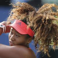 Naomi Osaka plays a shot during her first-round defeat to Barbora Strycova at the Pan Pacific Open on Monday.   AP