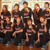 Japan's Asian hoop champs return home