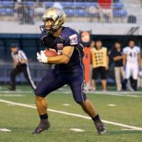 Obic Seagulls running back Takuya Furutani carries the ball after making a reception during a game against the Metropolitan Police Department Eagles on Saturday. The 39-year-old eclipsed 10,000 all-purpose career yards on the play. | KAZ NAGATSUKA