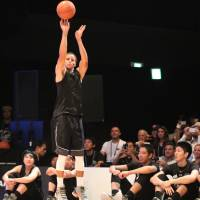 Stephen Curry demonstrates his shooting technique during a basketball clinic in Tokyo on Friday. | KAZ NAGATSUKA