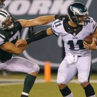 Eagles clear space for Tebow, trading Barkley to Cardinals