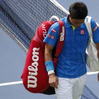 Kei Nishikori of Japan walks off the court Monday after his match against Benoit Paire of France on day one of the 2015 U.S. Open tennis tournament at USTA Billie Jean King National Tennis Center. in New York Paire won 6-4, 3-6, 4-6, 7-6 (8-6), 6-4. | GEOFF BURKE-USA TODAY SPORTS