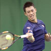 Kei Nishikori hits a shot during a practice session on Wednesday. | KYODO