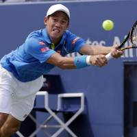 Kei Nishikori of Japan returns a shot to Benoit Paire of France during the first round of the U.S. Open tennis tournament Monday in New York. | AP