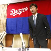 The Dragons' Michihiro Ogasawara bows during a news conference on Thursday in Nagoya. The 41-year-old is retiring at the end of the season. | KYODO