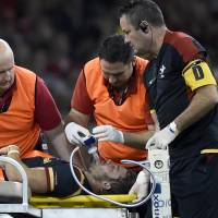 Leigh Halfpenny is given oxygen while being treated during Wales' match against Italy on Saturday. | REUTERS