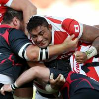 Amanaki Lelei Mafi (center) will try to help change the world's perception of Japan during the upcoming Rugby World Cup. | AP
