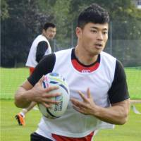 Japan's Akihito Yamada handles the ball during practice on Tuesday in Bristol, England. | KYODO