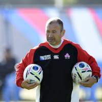 Brave Blossoms coach Eddie Jones, seen here during a training session on Monday in Warwick, England, is worried about the future of the sport in Japan. | AFP-JIJI