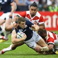 Scotland's Mark Bennett is tackled by Japan's Male Sa'u and Michael Leitch (right) | REUTERS