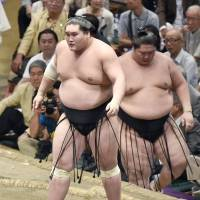 Terunofuji stands in the ring after beating Ichinojo at the Autumn Grand Sumo Tournament on Monday. | KYODO