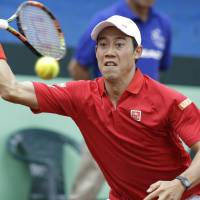 Kei Nishikori plays a shot against Colombia's Santiago Giraldo during their Davis Cup World Group playoff match on Sunday in Pereira, Colombia. | AP