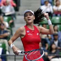 Agnieszka Radwanska celebrates after defeating Belinda Bencic in the final of the Pan Pacific Open on Sunday at Ariake Colosseum. | REUTERS