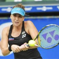 Belinda Bencic delivers a backhand return against Caroline Wozniacki on Saturday in the Pan Pacific Open semifinals at Ariake Colosseum. Bencic won 6-2, 6-4. | KYODO
