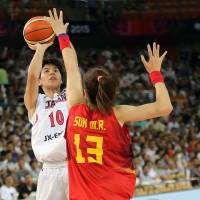 Japan's Ramu Tokashiki, seen shooting over China's Sun Mengran during the FIBA Asia Women's Championship on Sept. 5 in Wuhan, China, averaged 11.4 points as a WNBA rookie this season for the Seattle Storm.   AP