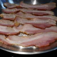 World Health Organization experts said last week that eating processed meat such as bacon can lead to bowel cancer in humans. | REUTERS