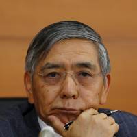 Bank of Japan Gov. Haruhiko Kuroda listens to a question during a news conference Friday at the central bank's headquarters in Tokyo.   REUTERS