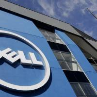 Dell Inc.'s offices in Santa Clara, California, glint in the sun. Dell is buying data storage company EMC for $67 billion. | AP