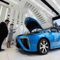 A Toyota Motor Corp. Mirai fuel cell-powered vehicle sits on display at the company's showroom in Tokyo. The construction of hydrogen refueling stations is behind schedule around the world. | BLOOMBERG
