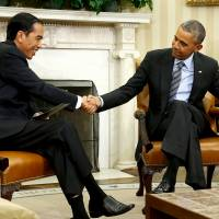 U.S. President Barack Obama and Indonesian President Joko Widodo shake hands after their meeting in the Oval Office of the White House in Washington on Monday. | REUTERS